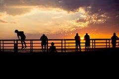 Siluette di tramonto Fotografie Stock Libere da Diritti