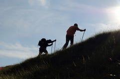 Siluette di trekking Fotografia Stock