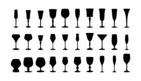 Siluette di vetro di vino messe. Fotografia Stock
