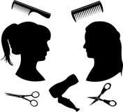 Siluette per un salone di lavoro di parrucchiere Fotografia Stock