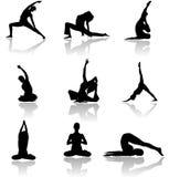 Siluettes d'homme et de femme de yoga Photo libre de droits
