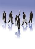 Siluettes dos homens de negócios Fotos de Stock Royalty Free