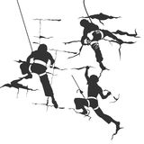 Siluetu climbing. Silhouettes of men that are climbing on the rocks. In the black colour Royalty Free Stock Images