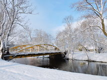 Silute town, Lithuania. Old yellow bridge over river Sysa in winter, Lithuania Stock Photos