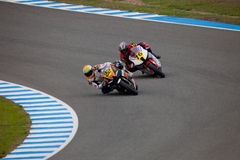 Silva and Mora pilot of MOTO2 in the CEV. JEREZ DE LA FRONTERA, SPAIN - NOV 20: MOTO2 motorcyclist Ivan Silva and Luis Miguel Mora takes a curve in the CEV Royalty Free Stock Photos