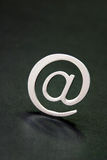 Silver 3D email sign. Against a black background Royalty Free Stock Images