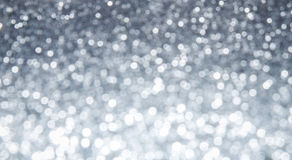 Silver abstract bokeh background - shiny and bright Stock Photography