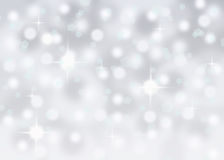Silver abstract bokeh snow falling winter christmas holiday background. With sparkles and glitter Stock Photos