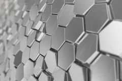 Silver abstract hexagonal background with depth of field effect. Structure of a large number of hexagons. Steel. Honeycomb wall texture, shiny hexagon clusters Stock Image