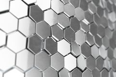 Silver abstract hexagonal background with depth of field effect. Structure of a large number of hexagons. Steel. Honeycomb wall texture, shiny hexagon clusters Royalty Free Stock Photography