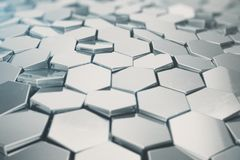 Silver abstract hexagonal background with depth of field effect. Structure of a large number of hexagons. Steel. Honeycomb wall texture, shiny hexagon clusters Royalty Free Stock Photo