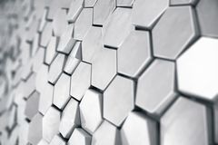 Silver abstract hexagonal background with depth of field effect. Structure of a large number of hexagons. Steel. Honeycomb wall texture, shiny hexagon clusters Stock Photo
