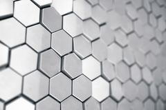 Silver abstract hexagonal background with depth of field effect. Structure of a large number of hexagons. Steel. Honeycomb wall texture, shiny hexagon clusters Stock Images