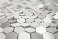 Silver abstract hexagonal background with depth of field effect. Structure of a large number of hexagons. Steel. Honeycomb wall texture, shiny hexagon clusters Royalty Free Stock Image