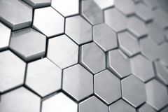 Silver abstract hexagonal background with depth of field effect. Structure of a large number of hexagons. Steel. Honeycomb wall texture, shiny hexagon clusters Stock Photos