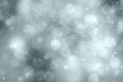 Silver abstract snowfall with sparkle background Stock Photos