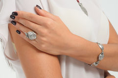 Silver accessory on woman. Finger ring, bracelet on model hand. Stock Image