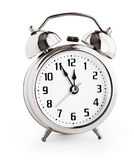 Silver alarm clock showing twelve hours with clipping path Stock Image