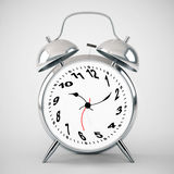 Silver alarm clock twisted Stock Photos