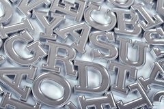 Silver alphabet letters as background stock photos
