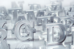 Silver alphabet letters close-up on a white stock photo