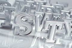 Silver alphabet letters close-up on a white royalty free stock photos