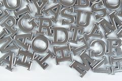 Silver alphabet letters on a white royalty free stock images