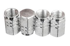 Silver aluminium tire valve caps Stock Photography