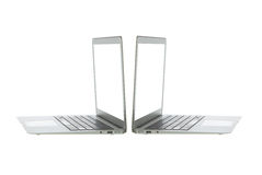 Silver aluminum laptop computer. Notebook keyboard and open slots on a white background Stock Image