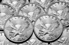 Silver American Coins Representing Wealth and Riches. Wealth and Riches represented by silver American coins royalty free stock image