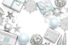Silver And Pastel Blue Christmas Gifts, Ornaments And Decorations Isolated On White Background. Christmas Border. Royalty Free Stock Photo