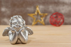 Silver angel over wooden background Stock Photography