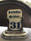 Silver antique old calendar Saturday 31st October Halloween old English font gothic Stock Photos