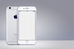 Silver Apple iPhone 7 mockup front and back side on gray background with copy space Stock Photo