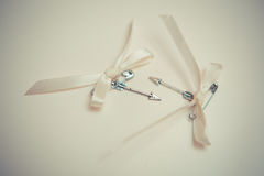 Silver arrows of love with bows. Stock Images
