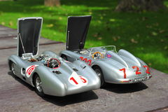 Silver arrows racing cars: Mercedes-Benz 300 SLR and Mercedes-Benz W196R. Beautiful Mercedes-Benz Silver Arrows driven by the famous driver Stirling Moss Royalty Free Stock Photo