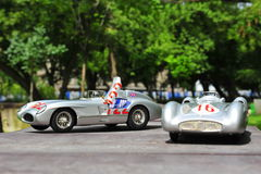 Silver arrows racing cars: Mercedes-Benz 300 SLR and Mercedes-Benz W196R. Beautiful Mercedes-Benz Silver Arrows driven by the famous driver Stirling Moss Royalty Free Stock Photos