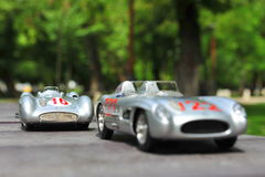 Silver arrows racing cars: Mercedes-Benz 300 SLR and Mercedes-Benz W196R Royalty Free Stock Images