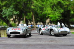 Silver arrows racing cars: Mercedes-Benz 300 SLR and Mercedes-Benz W196R. Beautiful Mercedes-Benz Silver Arrows driven by the famous driver Stirling Moss Stock Photos