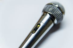 Silver audio microphone on white background. Surface stock photography