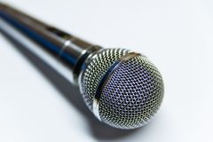 Silver audio microphone on white background. Surface stock photo