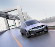Silver autonomous car driving on the highway. With monorail on background. 3D rendering image stock illustration