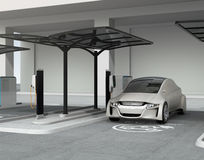 Silver autonomous car in electric vehicle charging station. 3D rendering image vector illustration