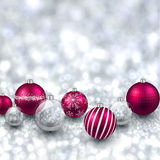 Silver background with magenta christmas balls. Stock Images