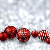Silver background with red christmas balls. Royalty Free Stock Image