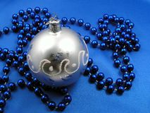 Silver ball and blue beads.  Royalty Free Stock Photography