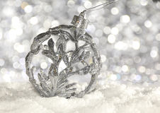 Silver Ball. Silver Christmas decoration on snow Stock Photo