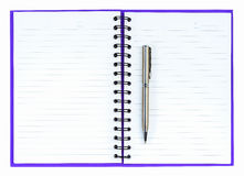 Silver ball point pen on purple notebook Royalty Free Stock Photo