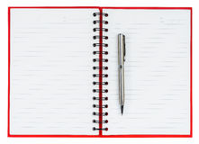 Silver ball point pen on red notebook Stock Photography