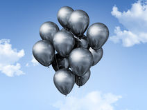 Silver balloons on a blue sky Stock Images